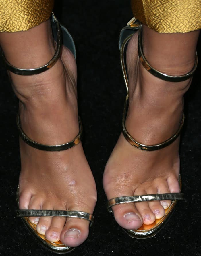 Emily wears the Giuseppe Zanotti 'Harmony' sandals in metallic leather