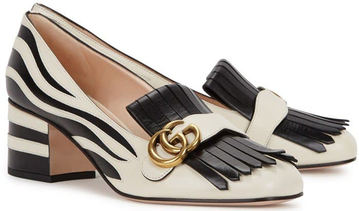 Kiltie fringe adds preppy elegance to a sleek, rounded square-toe pump set on a low chunky heel