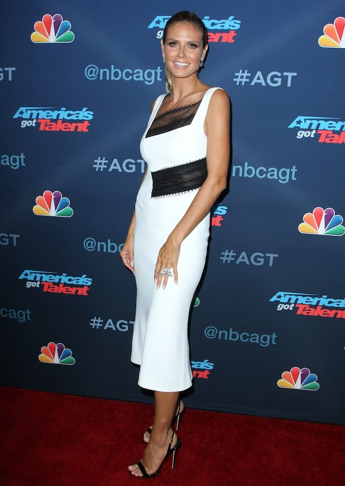 Heidi Klum in a black and white Roland Mouret dress that hugged her curves perfectly