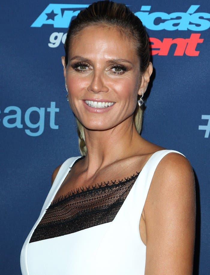 Heidi Klum kept her hair clean and simple with a high ponytail to show off the asymmetrical cuts of her dress