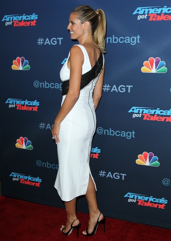 "Heidi Klum paired the $2,000 ""Clarival"" dress with black Giuseppe Zanotti ""Sophie"" slingback sandals"