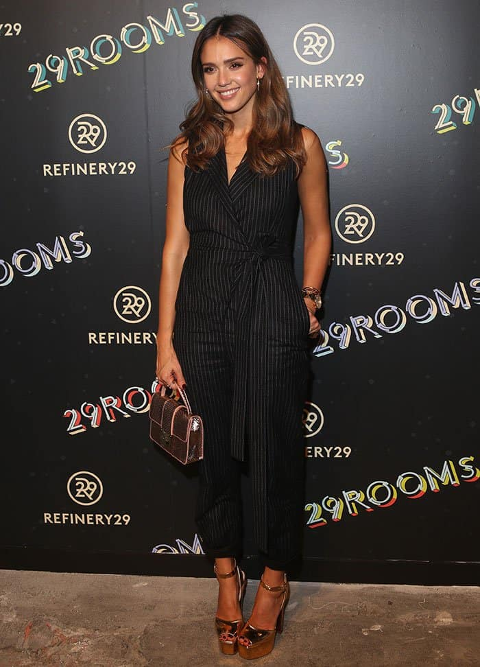 4e8b26fd650e Jessica Alba wore her honey-colored tresses down in gorgeous waves and  sported neutral makeup Jessica Alba in pinstripe jumpsuit