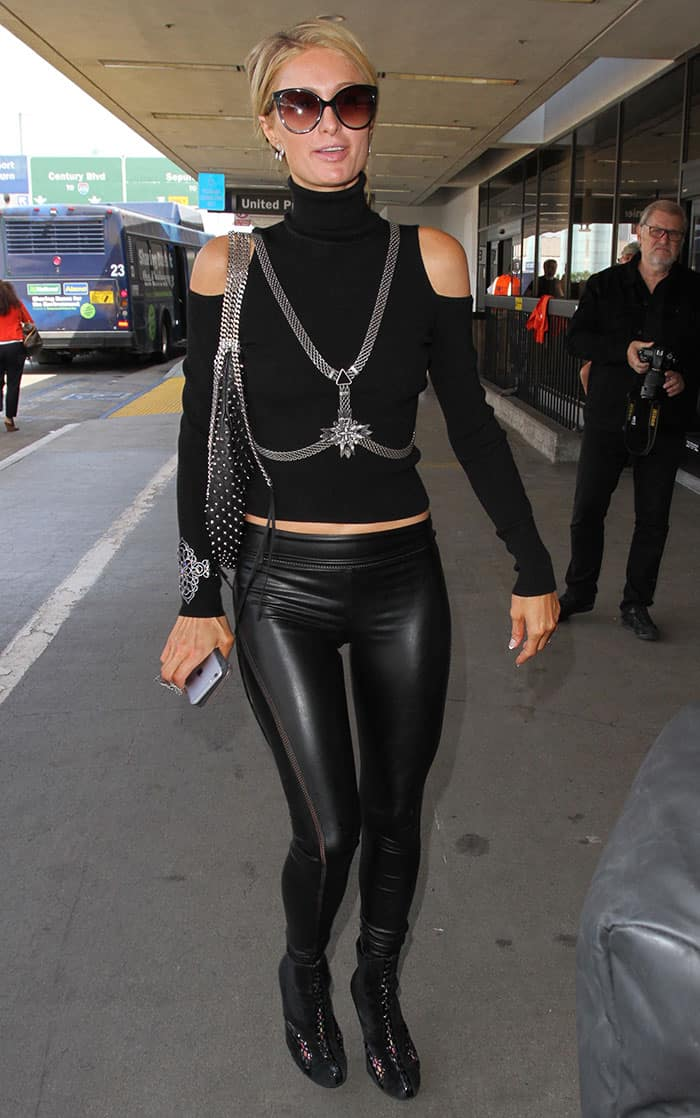 Paris Hilton In Alaia Patent Leather Paneled Suede Ankle Boots