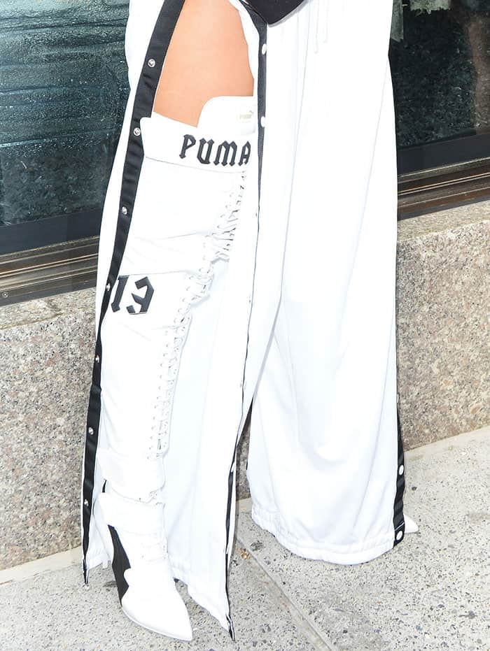 cfc85869f Rihanna left her pants unbuttoned to flash a hint of flesh and show off her  striking