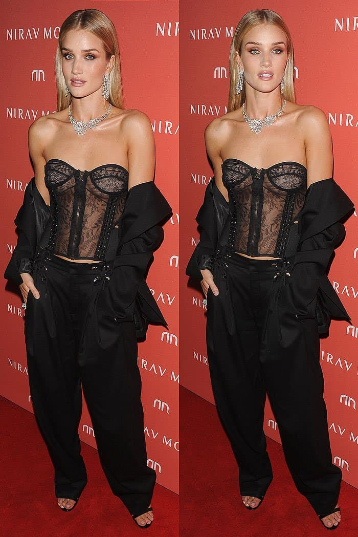 Rosie Huntington-Whiteley wore a classic Anthony Vaccarello blazer and a sexy lace bustier