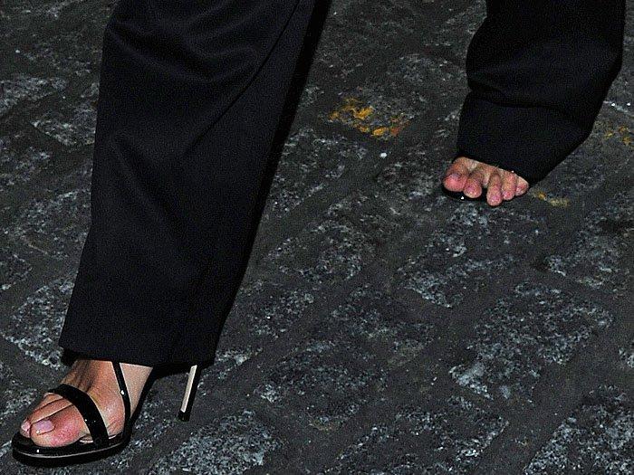 Rosie Huntington-Whiteley's toe overhang in black patent open-toe sandals