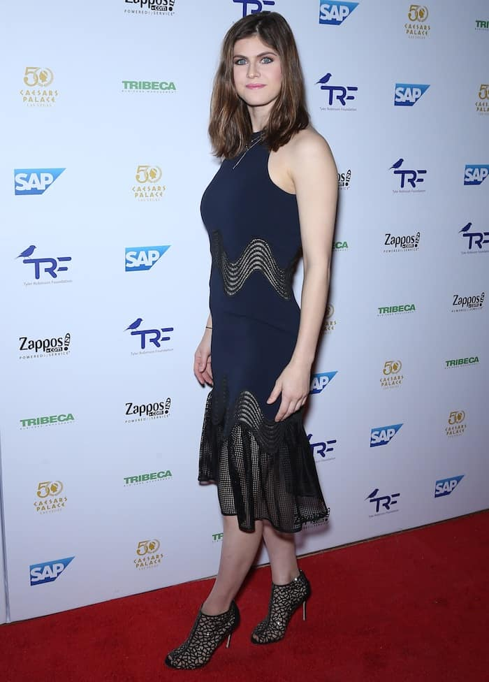 Alexandra Daddario walked the red carpet in a black sleeveless midi paired with crystal-embellished Sergio Rossi Tresor booties
