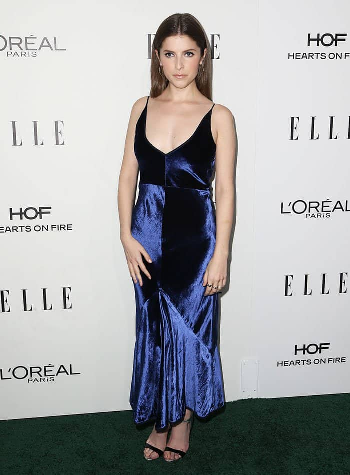 Anna Kendrick looks elegant with Dauphin jewelry, including a pair of earrings and a couple of rings