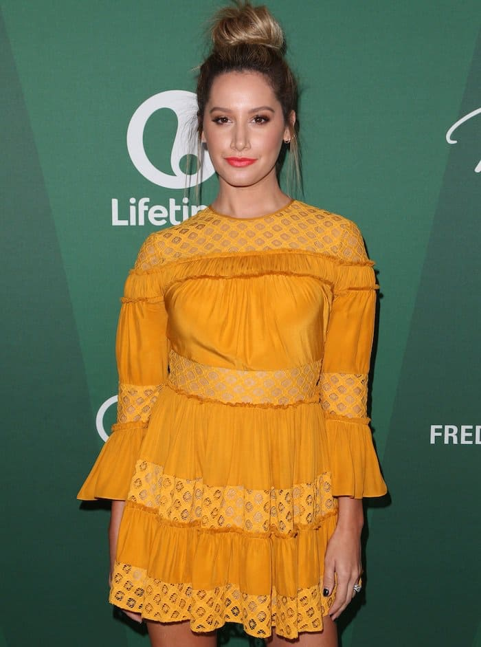 Ashley Tisdale's texture-rich Cinq a Sept dress is detailed with sheer, patterned cutwork and densely gathered trim
