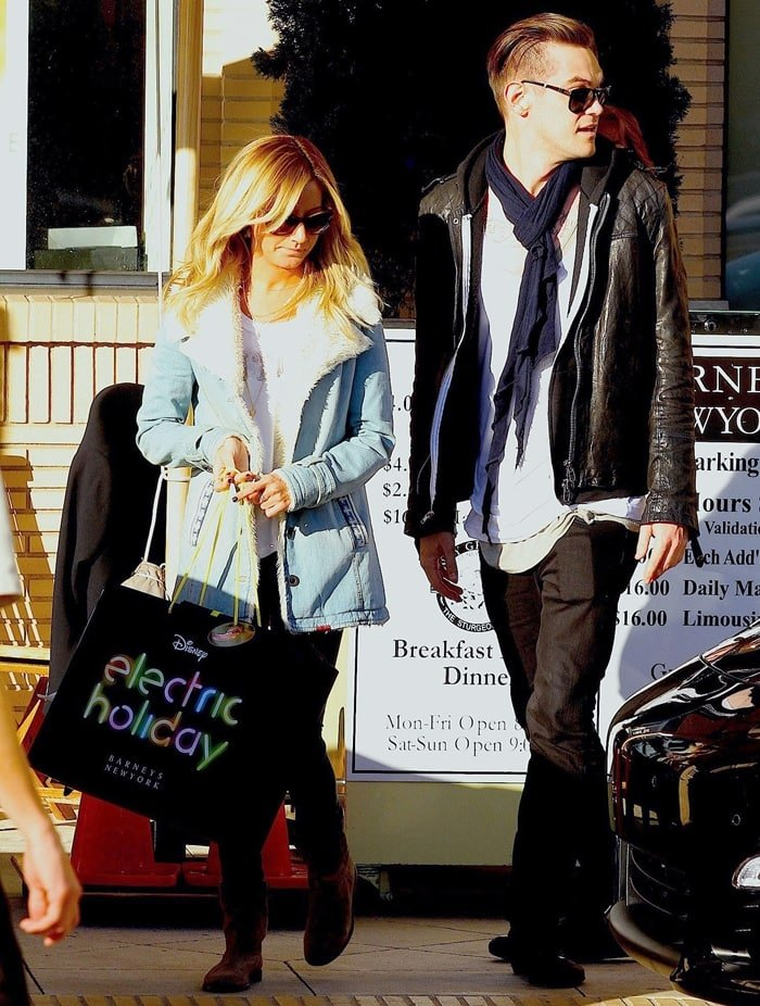 Ashley Tisdale and boyfriend Christopher French do a spot of last-minute Christmas shopping at Barneys New York