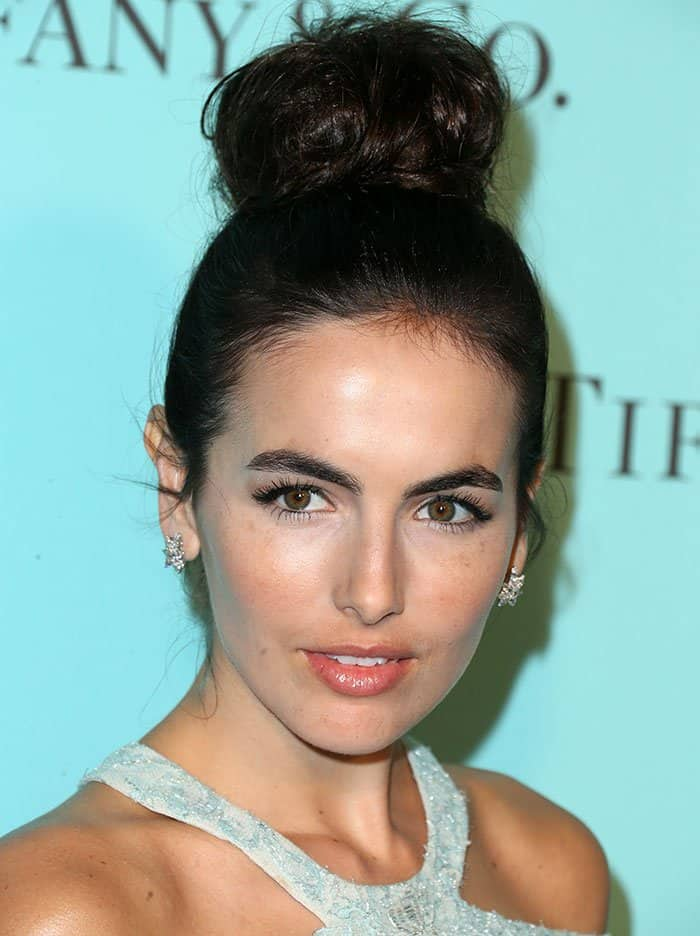 Camilla Belle's dark tresses were pulled up into a high bun