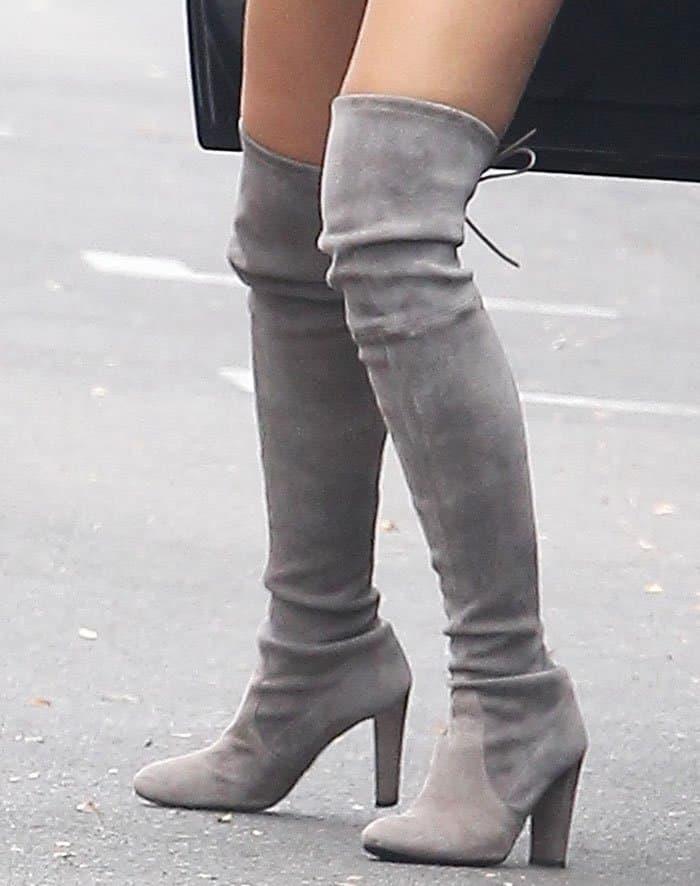 Cara Santana in Stuart Weitzman boots
