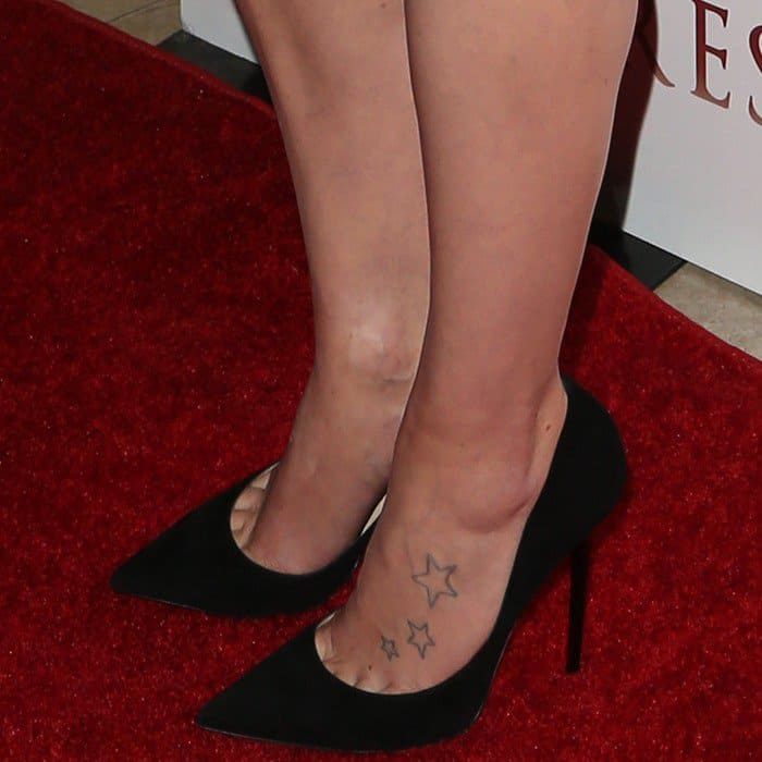 Daisy Ridley shows off her foot tattoo in a pair of black pointy-toe pumps