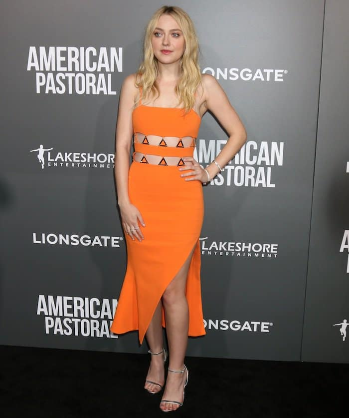 "Dakota Fanning is radiant at the LA Premiere of ""American Pastoral"" in an orange David Koma dress held at the Samuel Goldwyn Theater on October 13, 2016"