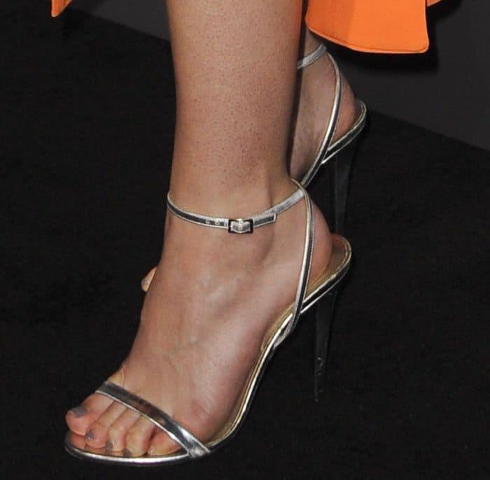 Dakota Fanning shows off her feet in Tamara Mellon Lipstick sandals