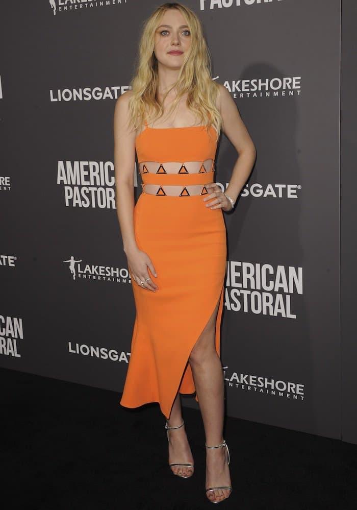 Dakota Fanning flaunts her legsin an orange David Koma dress