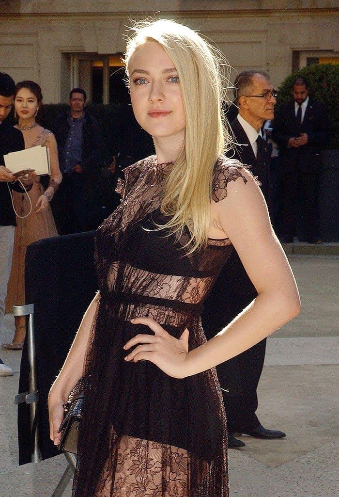Dakota Fanning in a see-through sheer lace dress
