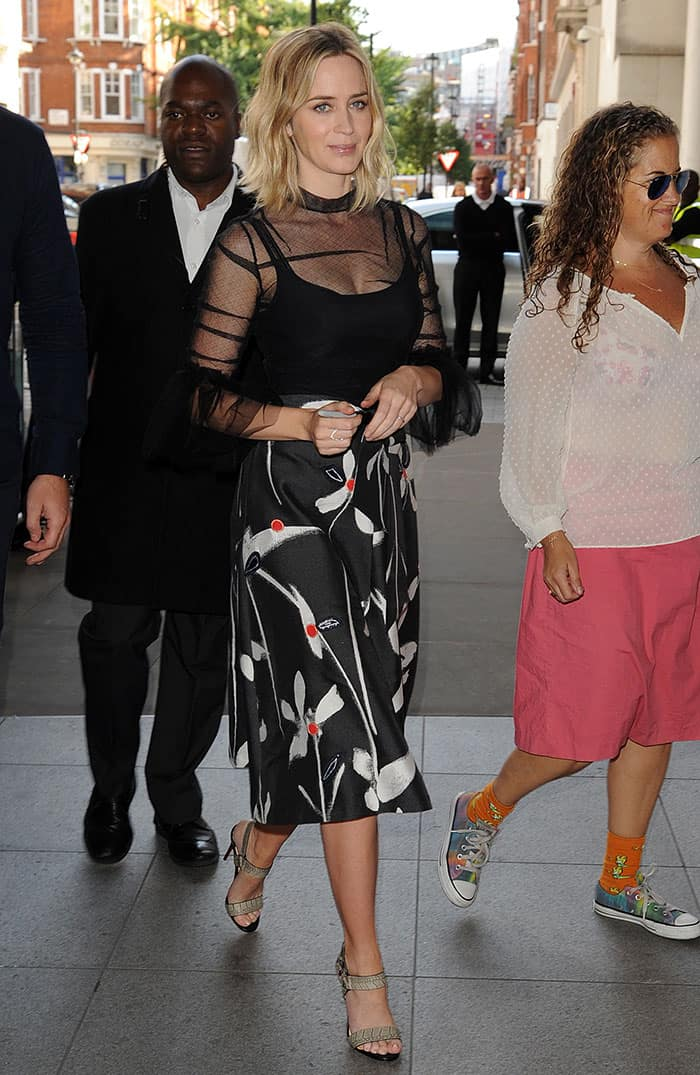 Emily Blunt wearing a floral-patterned midi skirt by Sachin & Babi