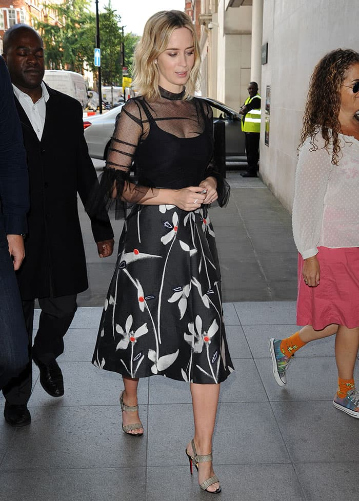 Emily Blunt flaunting her legs in a Burberry sheer top and a Sachin & Babi midi skirt