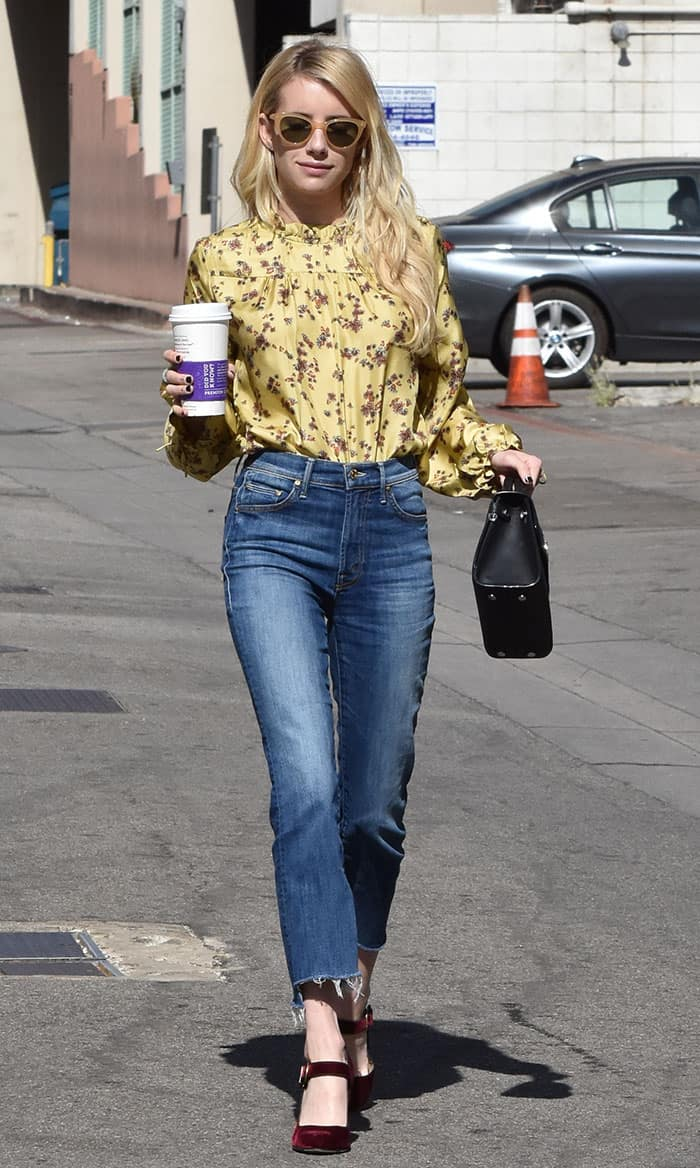 Emma Roberts opted for a bohemian-inspired look in a yellow floral-printed blouse by Wilfred for Aritzia