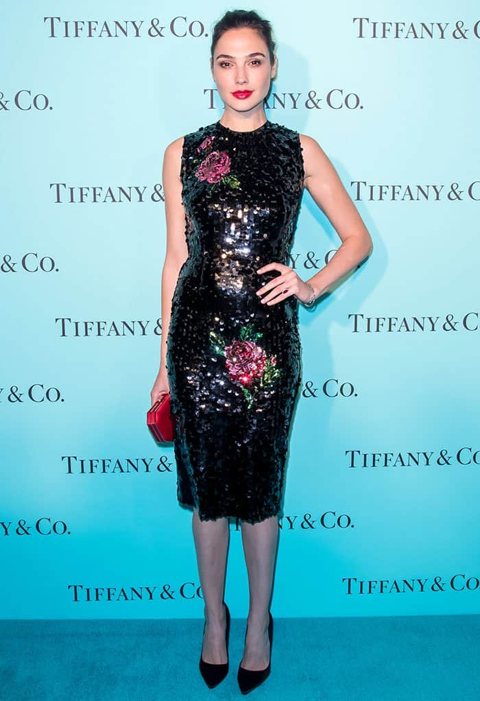 Gal Gadot flaunts her legs in a form-fitting sleeveless dress by Dolce & Gabbana