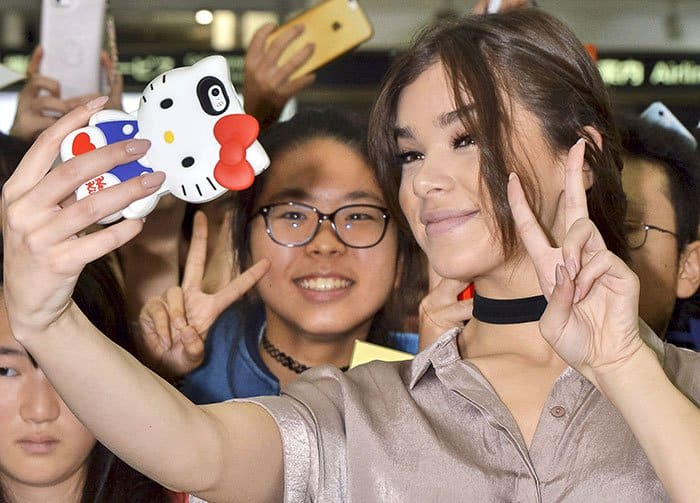 Hailee Steinfeld wore nude nail polish and matching pale nude lipstick to play up the muted color of her look