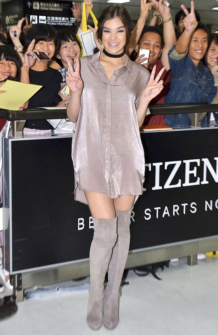 Hailee Steinfeld had her legs on display in a Meshki thigh-skimming shirt dress and a pair of racy thigh-high boots