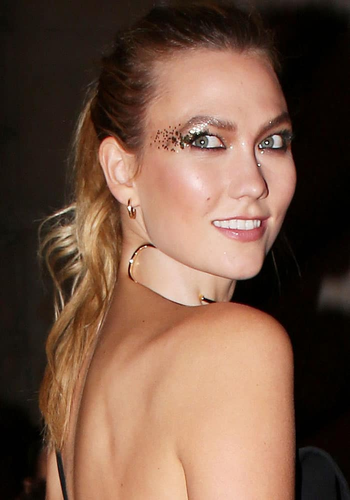 """Karlie Kloss at the """"Gold Obsession"""" party by L'Oreal Paris at held at the French National Money Institution in Paris on October 2, 2016"""