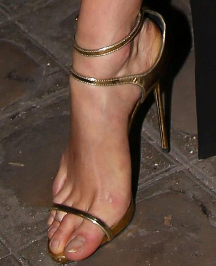 """Gold obsession, indeed: Karlie wore a pair of gorgeous metallic """"Darcie"""" sandals from Giuseppe Zanotti"""