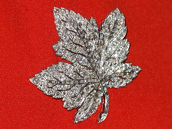 The Duchess of Cambridge borrows a maple leaf brooch from her grandmother, Queen Elizabeth