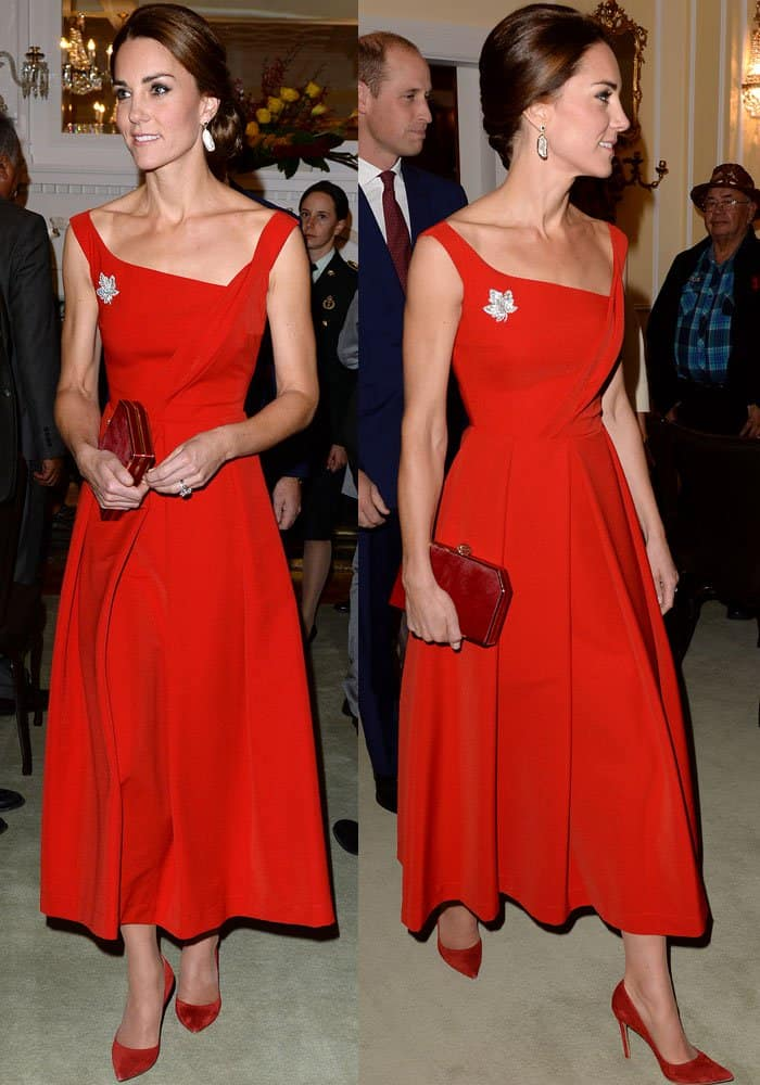 Kate turns heads at the leaders' dinner in a red Preen Finella dress