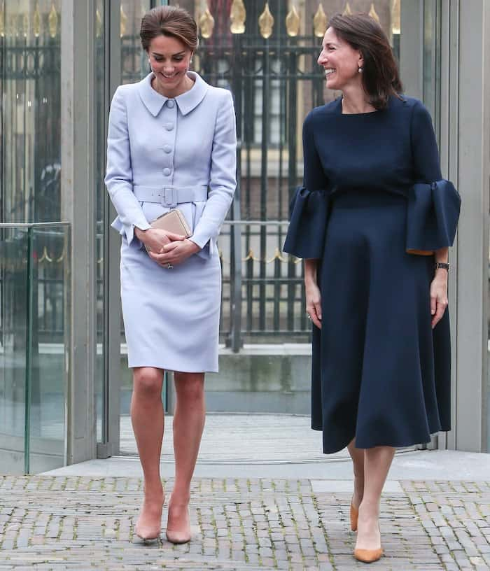 Kate Middleton in a powder blue Catherine Walker suit paired with Gianvito Rossi suede pumps for her first out of town trip alone to Holland on October 12, 2016