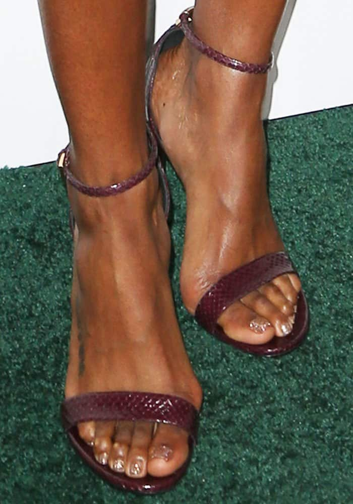 Kelly Rowland shows off her feet in Tom Ford sandals in burgundy reptile print-embossed leather