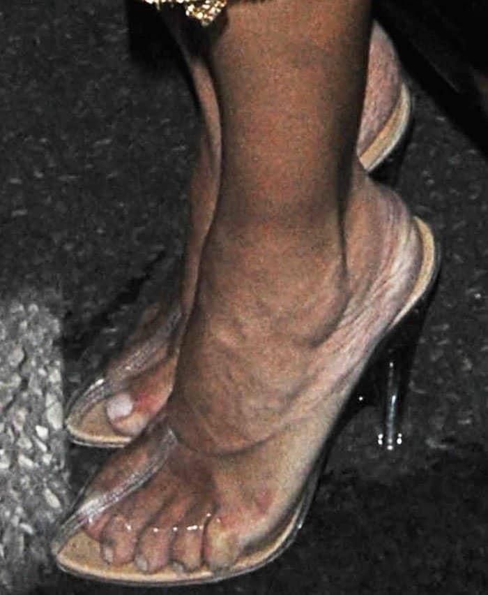 Kim Kardashian shows off her feet in Kanye's controversial Yeezy Season 4 plastic heels
