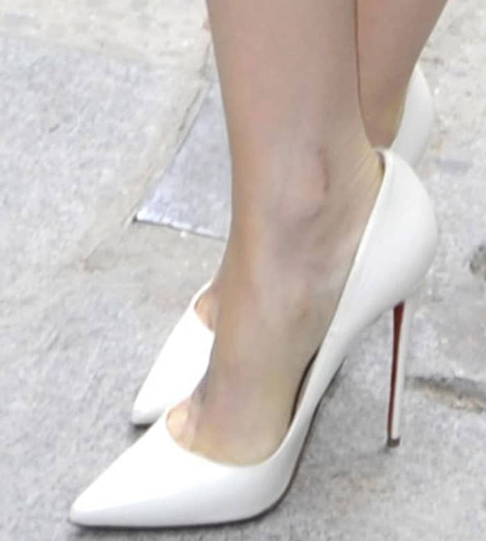 Lily Collins shows off her feet in white So Kate pumps