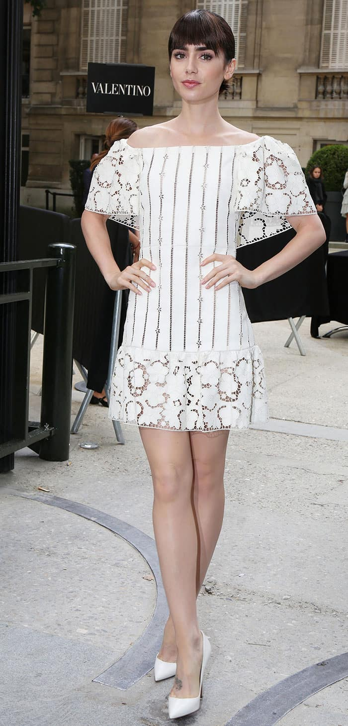 Lily Collins flaunts her legs in a white Bardot-style dress at the Valentino show