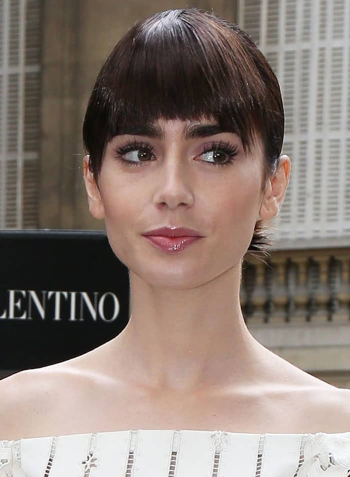 Lily Collinspulled her hair back into a chic updo with afringe cut just right above her signature eyebrows