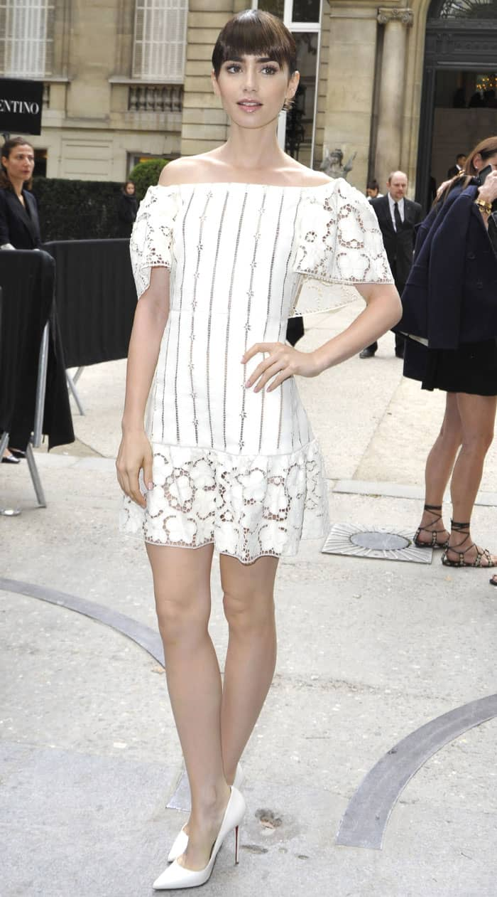 Lily Collins parades her legs in a white Bardot dress