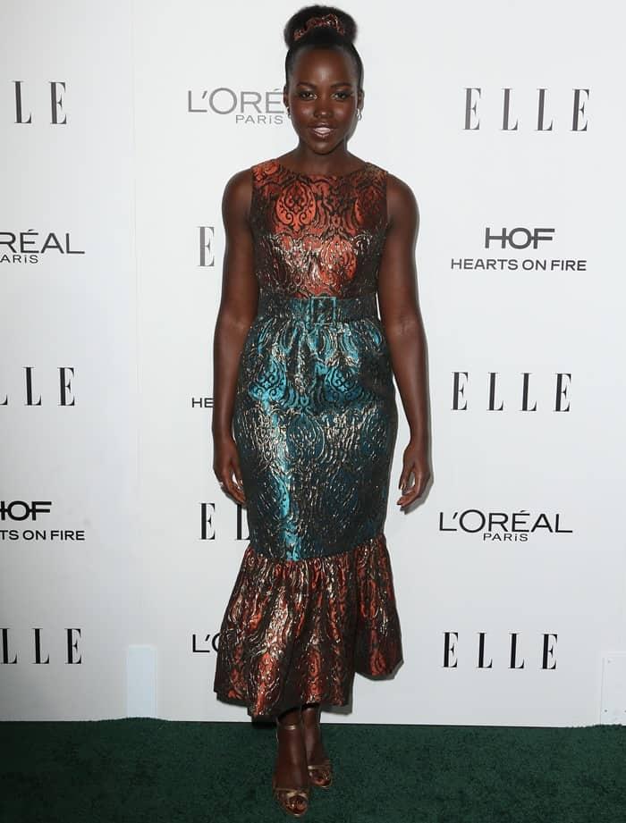 Lupita Nyong'o donned a belted Duro Olowu jacquard trumpet dress
