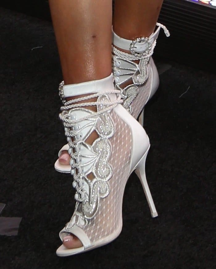 Nicki Minaj's booties feature crystal-embellished buckles and embroidered panels