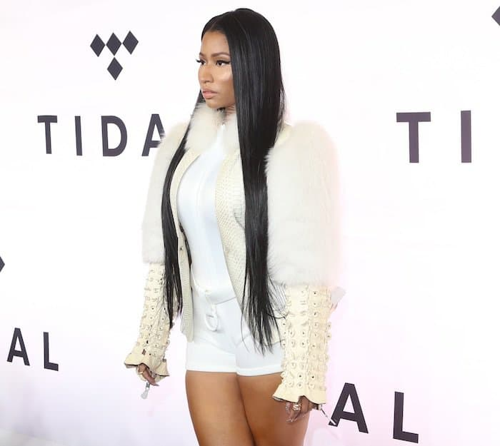 Nicki Minaj wearing a sexy yet chic ensemble that included a pair of white shorts and a white fur coat
