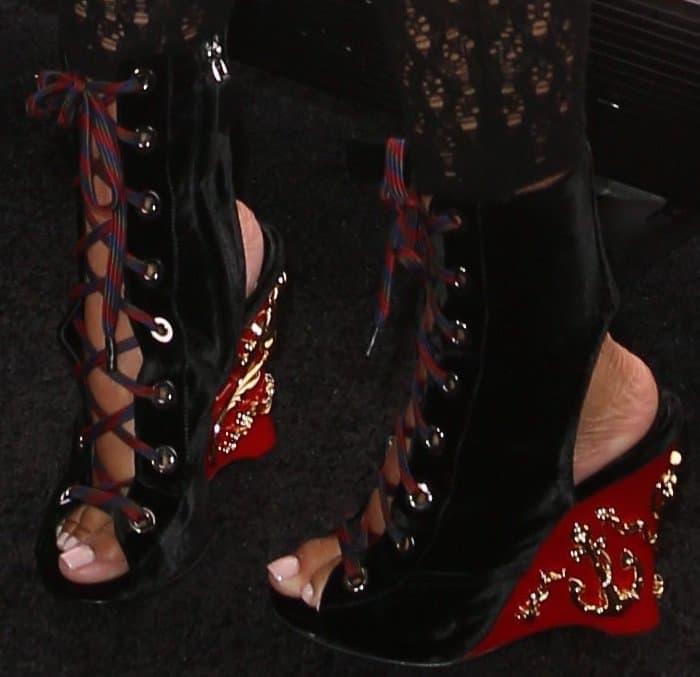 Nicki Minaj pairs her bodysuit with Prada embellished wedge booties