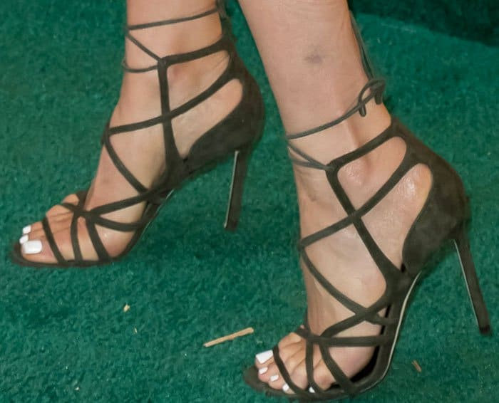 Olivia got ready for grass-stomping in a pair of green suede Jimmy Choo 'Tess' sandals