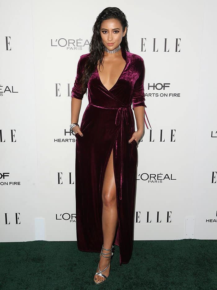 Shay Mitchell broke the cardinal fashion rule and flaunted both legs and cleavage in the floor-length number