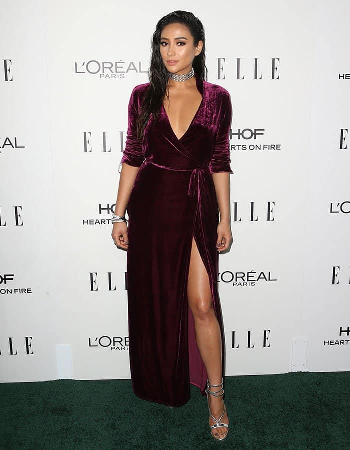Shay Mitchell went the vampy route in a Bordeaux velvet Attico dress