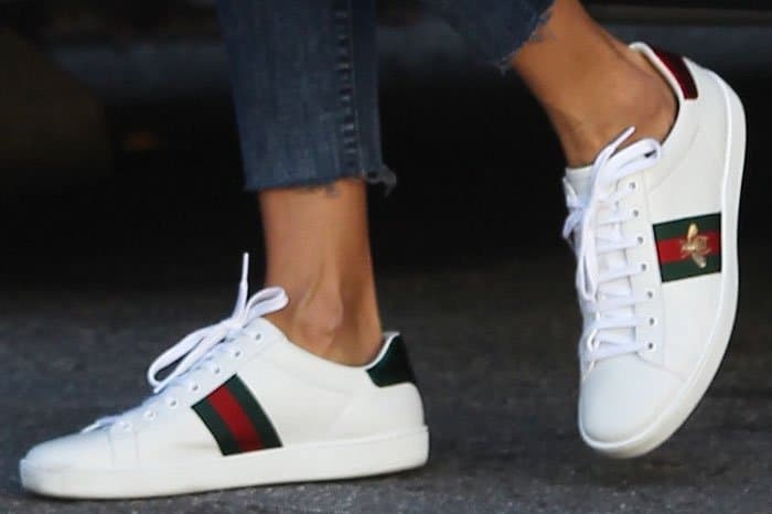 f9242f17986 Alessandra goes for the low-key bee embroidery on her Gucci Ace sneakers
