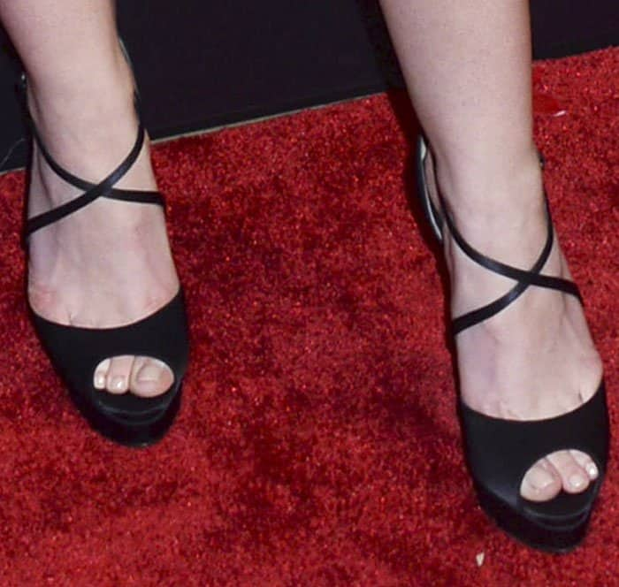 """Dakota Fanning adds height with Christian Louboutin's """"Cross Me"""" sandals"""