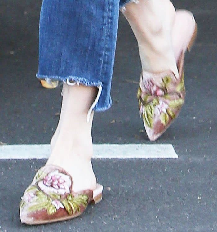 Emma spends a morning in the salon in her Alberta Ferretti slip-on embroidered mules