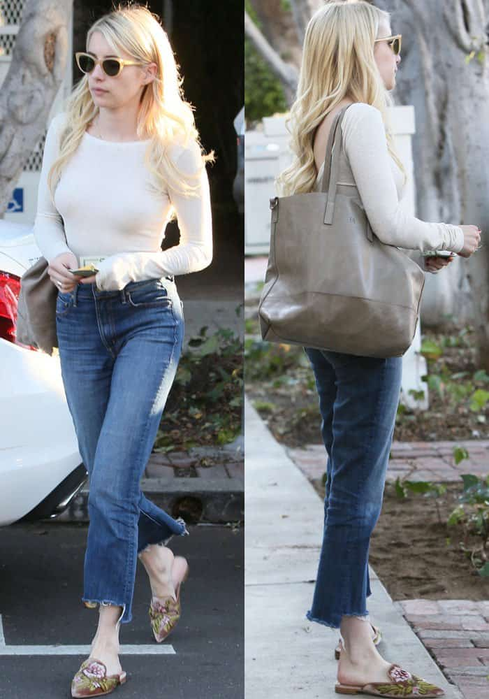 Emma Roberts kept her look casual in a long-sleeved top and jeans