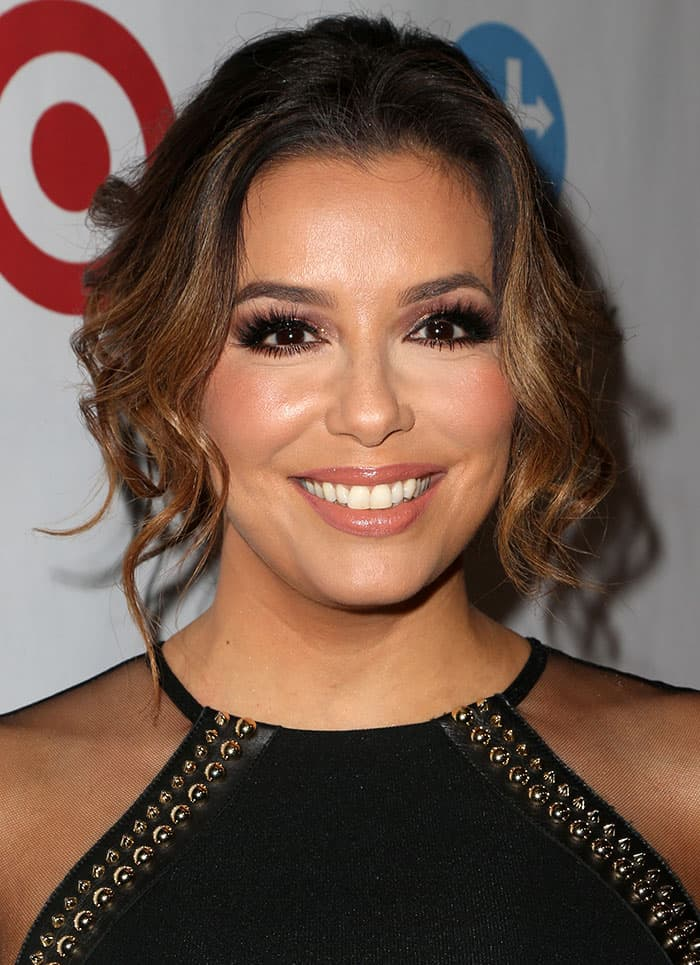 Eva Longoria wore her tresses in a chic updo, with few tendrils framing her face